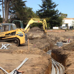 Excavating a conduit trench