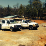 Two solar trucks sitting on an excavated work site